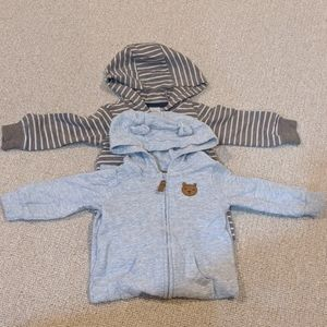 Two Carter's Size 9 month hooded jumpsuits